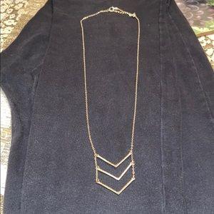 Triple V long gold necklace